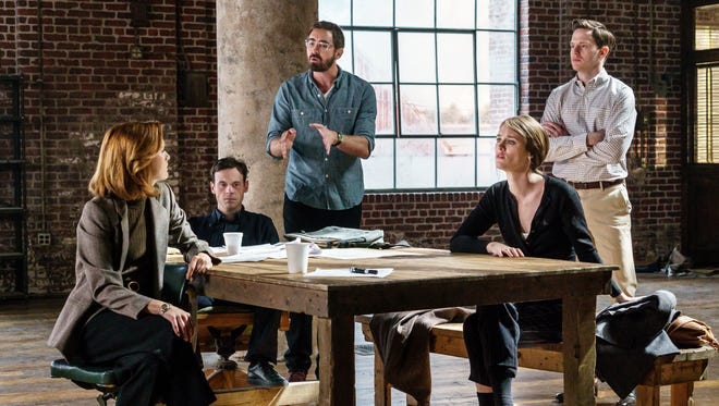 Donna (Kerry Bishé, left),  Gordon (Scoot McNairy), Joe (Lee Pace), Cameron (Mackenzie Davis) and Tom (Mark O'Brien) gather during Season 3 of AMC's 'Halt and Catch Fire.'