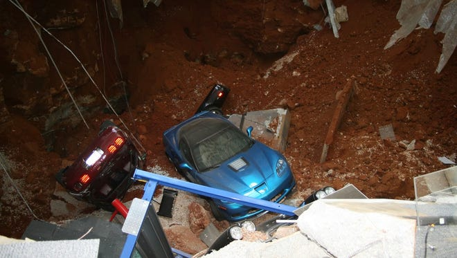 Cars in a sinkhole that opened up underneath the Corvette Museum in Bowling Green.