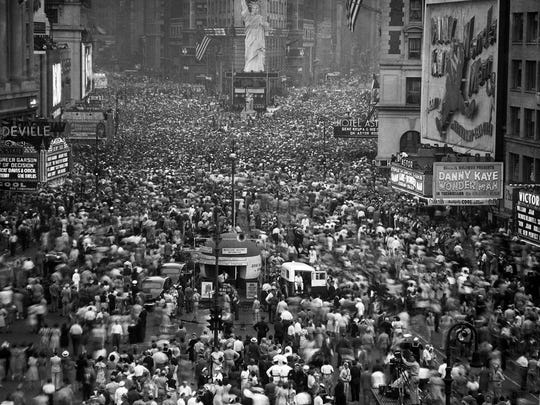 Thousands jammed New York's Times Square after President Harry Truman announced Japan's unconditional surrender on Aug. 14, 1945. There's a replica of the Statue of Liberty as well.