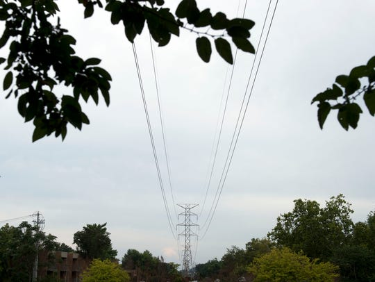 TVA power lines span above shopping complexes and neighborhoods