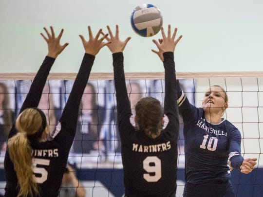 Marysville's Hannah Delor spikes the ball during a Class B district semifinal volleyball game Thursday, Nov. 3, 2016 at Marysville High School.