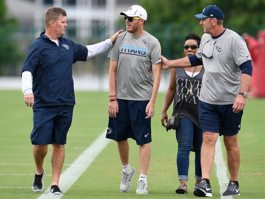 Titans general manager Jon Robinson and head coach Mike Mularkey visit with former Titan Tim Shaw as they walk off the field following a mini-camp practice at St. Thomas Sports Park Thursday, June 15, 2017, in Nashville, Tenn.