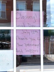 A closing sign posts on the door of S&S Cafe off from Main Street Tuesday afternoon in Mosinee.