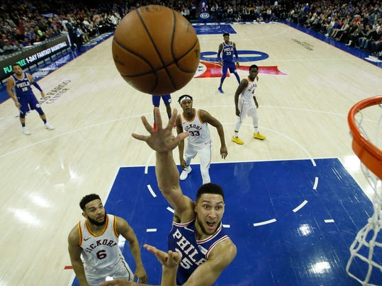 Philadelphia 76ers' Ben Simmons (25) goes up for a shot past Indiana Pacers' Cory Joseph (6) during the first half of an NBA basketball game, Tuesday, March 13, 2018, in Philadelphia. (AP Photo/Matt Slocum)