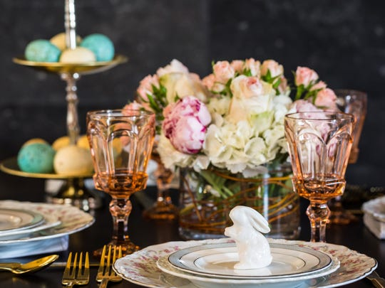 Contemporary ceramic bunnies give the feel of Easter, as well as fresh baby pink tea roses and white hydrangeas in a clear glass cylinder to complement the rosebud plates.