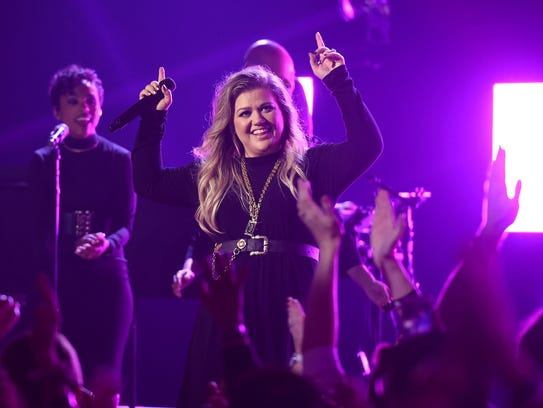 Singer/songwriter Kelly Clarkson performs at the iHeartRadio