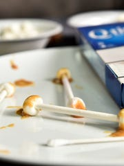 Used Qtips of caramel and marshmallow add a touch of class to a scary Halloween snack.