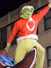 The Grinch hams it up for those out to view Waynesboro's Christmas Parade Saturday evening, Dec. 5, 2015.