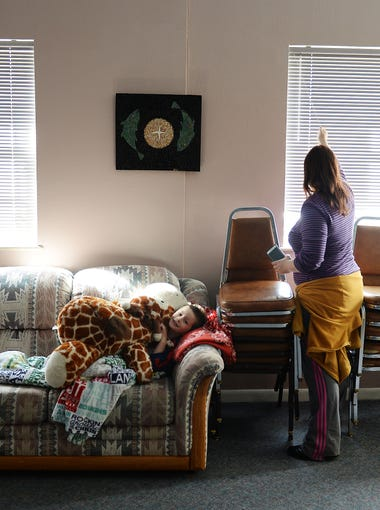 Fawn Martin puts her son, Zayden Slone, 5, down for a nap at the Faith Family Hospitality day center at the Fort Collins Mennonite Fellowship on March 3, 2016. The day center provides a living space and kitchen before their host church is open for the evening.