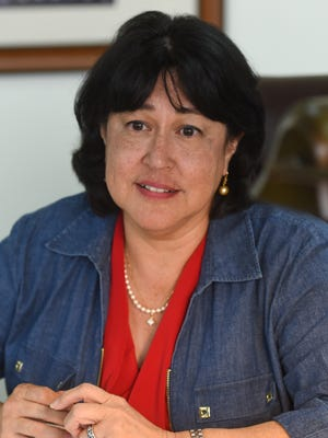 Attorney General Elizabeth Barrett-Anderson discusses legal challenges involving the Chamorro Land Trust and the political status plebiscite during an interview at the International Trade Center on March 21, 2017.