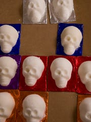 Sugar skulls will soon be decorated with colorful icing as part of teacher Eric Ridenour's Day of the Dead project at Montessori Academy.