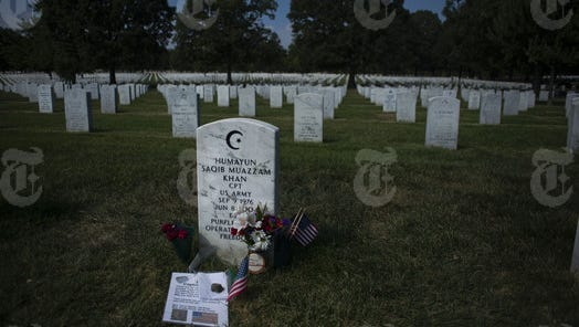 The grave of U.S. Army Capt. Humayun Khan, who was killed fighting in Iraq, at Arlington National Cemetery in Arlington, Virginia, Sept. 7, 2016. The grave of the Muslim soldier whose parents denounced Donald Trump has drawn thousands of visitors since late July, emerging as a kind of organic meeting point. (Gabriella Demczuk/The New York Times)