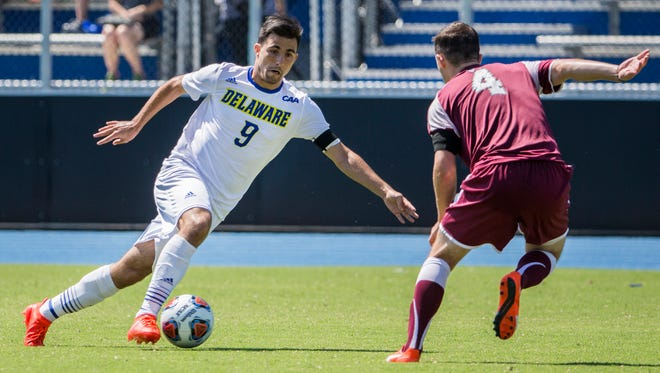 Delaware's Guillermo Delgado (No. 9) looks to cut past Fordham's Andrew Hickey (No. 4) in the second half of Delaware's 1-0 win over Fordham at Grant Stadium at the University of Delaware on Sunday afternoon.
