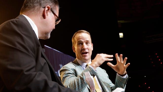 Peyton Manning talks with Kevin Foote during the Daily Advertiser Sports Awards at the Cajundome on Wednesday night May 10, 2017.