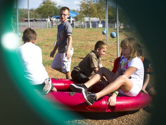 Students play on the playground at Four Peaks Elementary