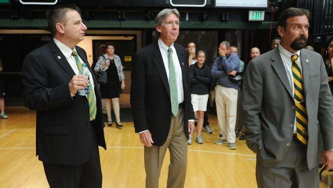 CSU President, Dr. Tony Frank, right, athletic dDirector, Jack Graham, middle, and Larry Eustachy, left, walk into Moby Arena, at the introduction of Eustachy as the new head basketball coach at CSU Thursday April 12, 2012.