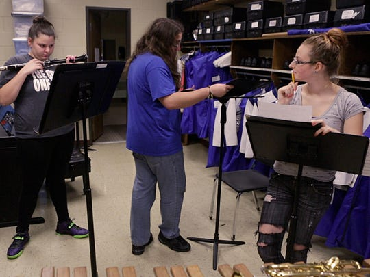 From left to right, Brianna Dickensheets, Kyle LeGore and Kaitlyn Croyl get ready to practice together during band class at Robert E. Lee on Nov. 19, 2015.