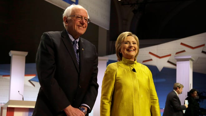 Democratic presidential candidates Sen. Bernie Sanders and Hillary Clinton take the stage before a debate at the University of Wisconsin-Milwaukee on Feb. 11, 2016.