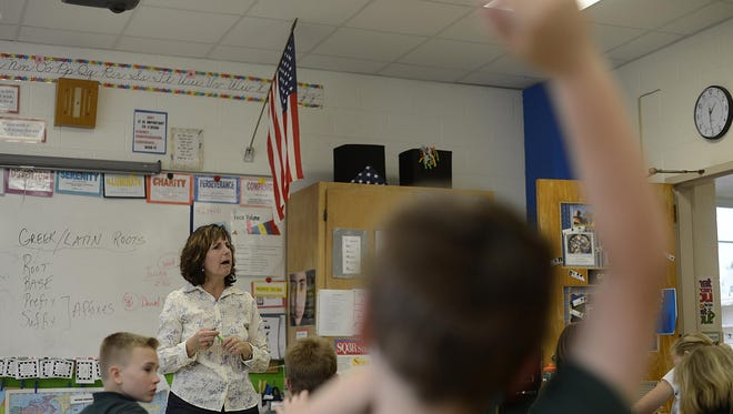 Kathy Schumacher teaches Greek and Latin roots in her fifth-grade class at St. Matthew's and Resurrection Catholic School in Allouez in May.