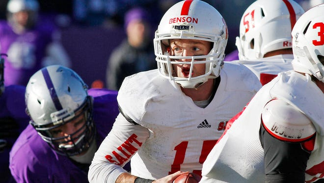 St. John's University quarterback Johnny Benson drops back into the pocket to throw against St. Thomas during the second half Saturday, Nov. 28, at O'Shaughnessy Stadium in St. Paul.