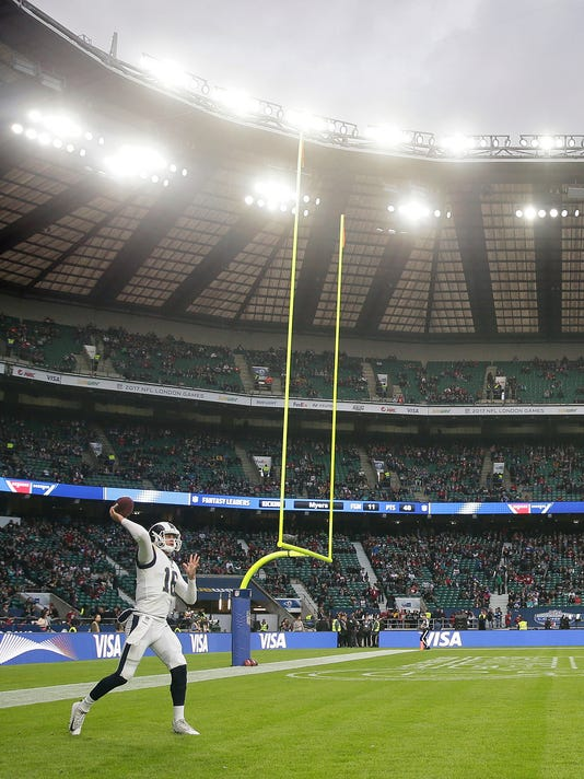 FILE - In this Oct. 22, 2017, file photo, Los Angeles Rams quarterback Jared Goff warms up before an NFL football game against Arizona Cardinals at Twickenham Stadium in London. Goff is among the NFL's most effective quarterbacks after just eight games under Sean McVay. The new coach insists Goff deserves much of the credit. (AP Photo/Tim Ireland, File)