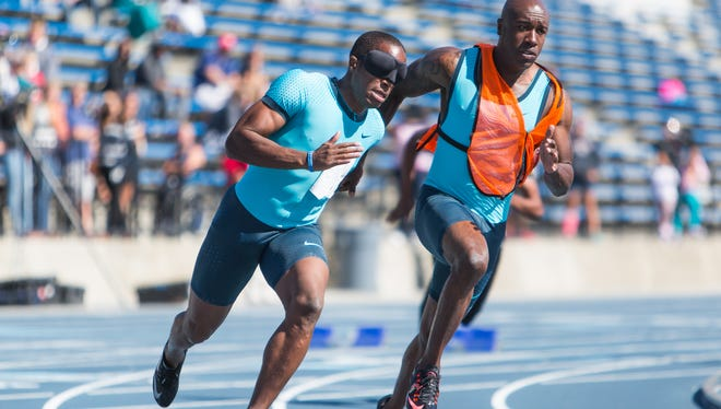 Guide runner Jerome Avery, who owns a personal best of 10.17 in the 100 meters, becomes David Brown's eyes when they compete in meets.