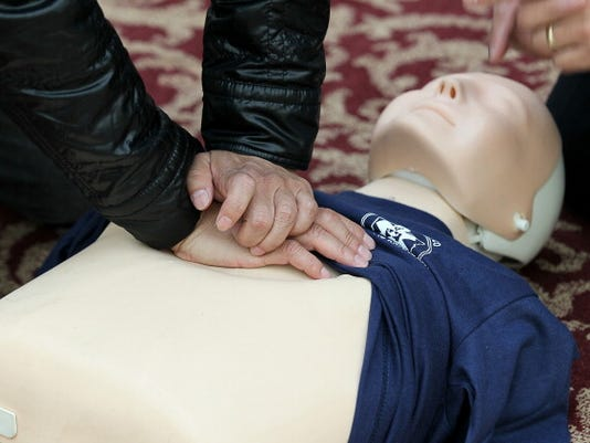 Paramedics Demonstrate CPR Techniques In San Francisco