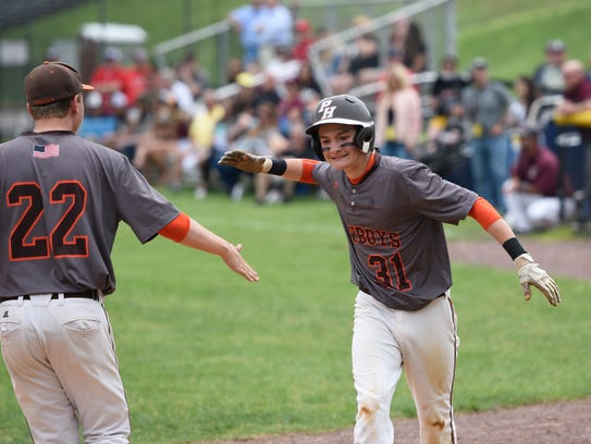 Pascack Hills' Mike Rodriguez (31) high-fives Paul