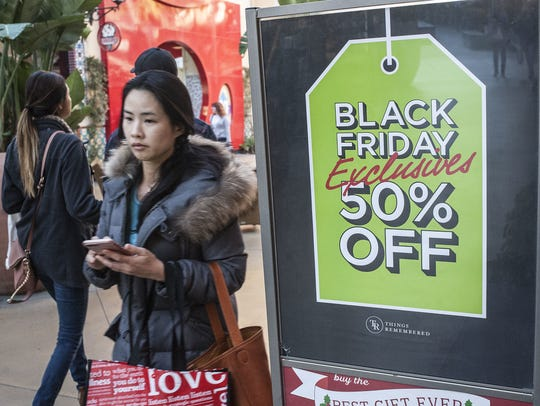 Shoppers look for deals at the Irvine Spectrum Center