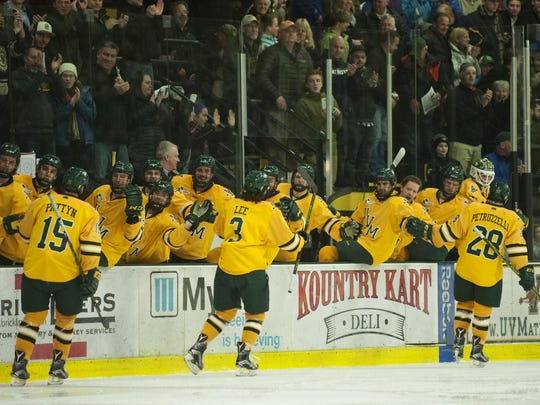 The Catamounts celebrate a goal during the men's hockey game between the Boston College Eagles and the Vermont Catamounts at Gutterson Fieldhouse earlier this season.
