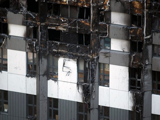 Burned areas of cladding on Grenfell Tower. Authorities