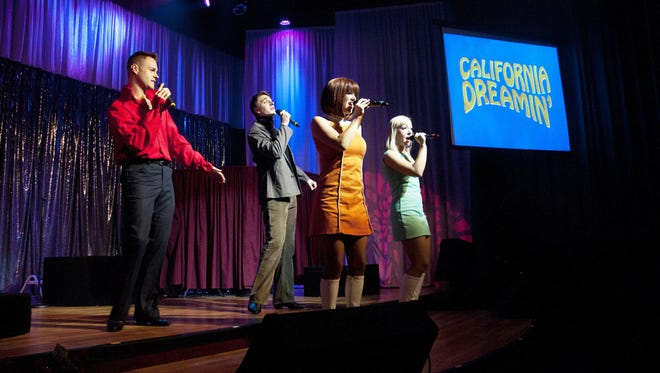 Members of the California Dreamin' cast perform at a show.