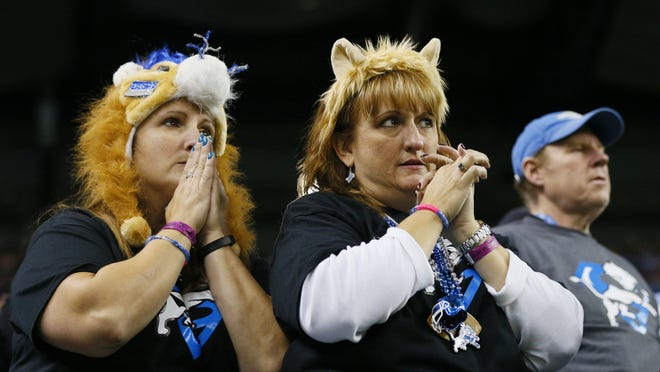 Detroit Lions fans wait patiently during the closing minutes of their 24-23 win over the New Orleans Saints during the second half of an NFL football game in Detroit, Sunday, Oct. 19, 2014. (AP Photo/Rick Osentoski)