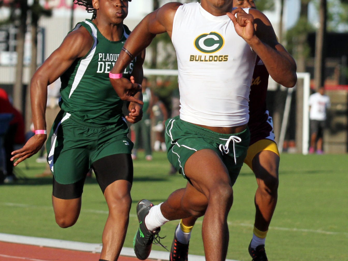Cecilia's Raymond Calais Jr. finishes first in the 100 during Wednesday's Class 4A regional meet at UL's Track Complex.
