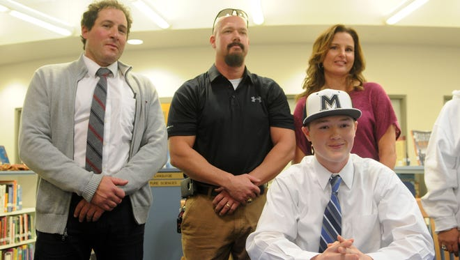 Stephen Decatur's Zachary Adams signs his national letter of intent to play baseball at Mount Saint Mary's.