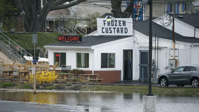 Some flooding next to Don's Original at Sea Breeze, as rising water levels in the Irondequoit Bay area prompt residents to take emergency measures.