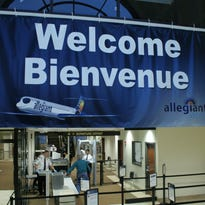 Plattsburgh International Airport in Upstate New York welcomes French Canadian customers with bilingual signage.