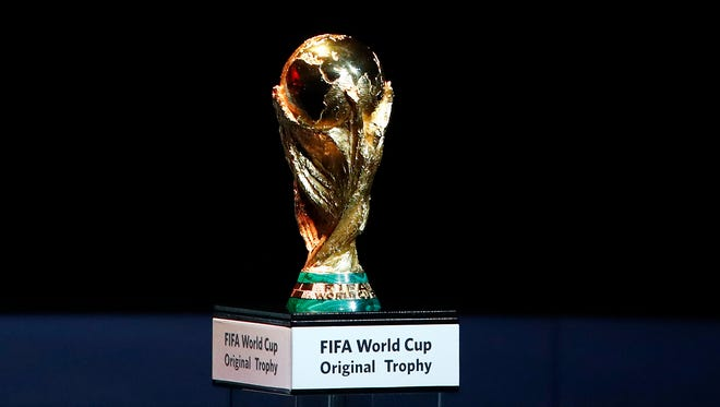 A Friday Dec. 1, 2017 file photo of the World Cup trophy placed on display during the 2018 soccer World Cup draw in the Kremlin in Moscow.