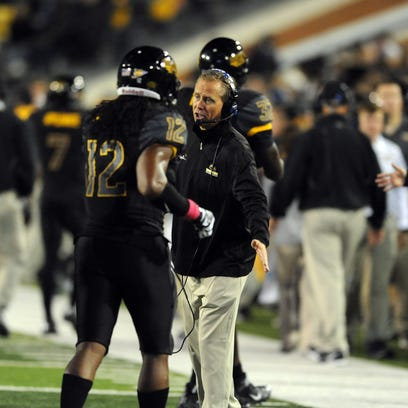 Southern Miss head coach Todd Monken speaks to his