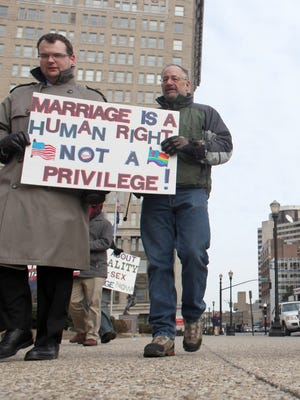 Protesters march for marriage equality on Jan. 22, 2013, in Louisville, Ky.