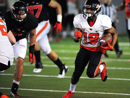 Oregon State wide receiver Xavier Hawkins runs after a catch during a scrimmage in the Merrit Truax Indoor Practice Facillity, on Saturday, March 14, 2015, in Corvallis.