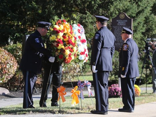 Wreaths are laid at the Brinks Memorial in Nyack on