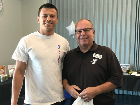 The Y's Sports & Wellness Director Lee Pinkham, left, is seen with volunteer Anthony DeLucia (also known on the island as Steve Reynolds).