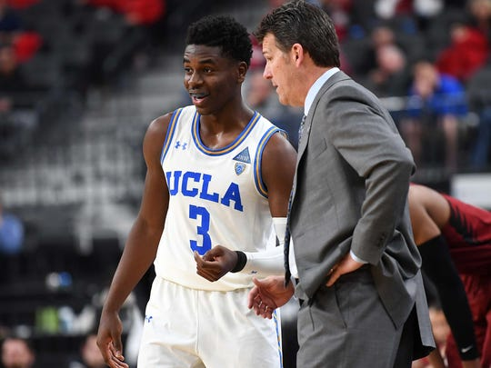 Mar 8, 2018; Las Vegas, NV, USA; UCLA Bruins head coach Steve Alford talks with UCLA Bruins guard Aaron Holiday (3) during a quarterfinal match against the Stanford Cardinal in the Pac-12 Tournament at T-Mobile Arena. Mandatory Credit: Stephen R. Sylvanie-USA TODAY Sports