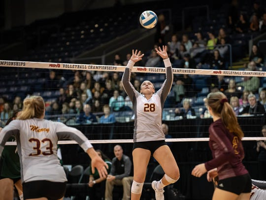 Farmington Hills Mercy's Julia Bishop (28) sets the ball during MHSAA Volleyball semifinals at Kellogg Arena in Battle Creek on Friday.