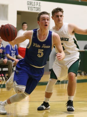 White House's Jared Ward goes to the basket against Greenbrier. White House won 62-59.