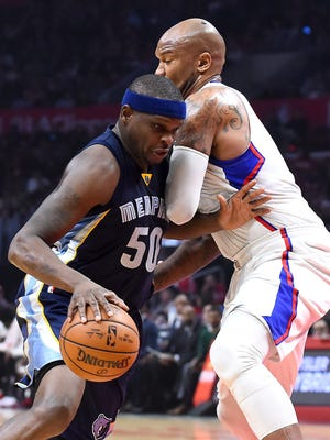 Jan 4, 2017; Los Angeles, CA, USA;  Memphis Grizzlies forward Zach Randolph (50) is fouled by Los Angeles Clippers guard Raymond Felton (2) as he drives to the basket in the first half at Staples Center. Mandatory Credit: Jayne Kamin-Oncea-USA TODAY Sports