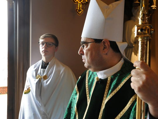 Bishop Michael Duca at The Cathedral of St. John Berchmans.