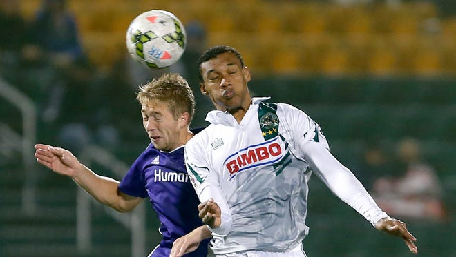 Rochester Rhinos' Steevan Humberto Fortes dos Santos and Louisville City's Bryan Burke jump for the ball in the first half at Sahlen's Stadium in Rochester.