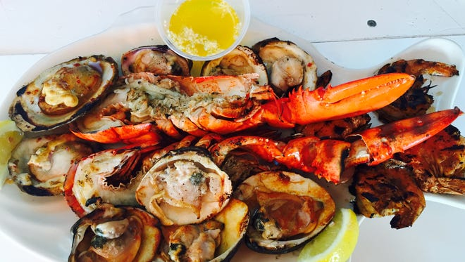 At Red's Lobster Pot, enjoy a  grilled seafood sampler out on the deck.